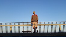 Man Standing By Railing