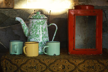 Teapot And Teacup Called Blirik In Indonesian With Can Of Cracker On The Table