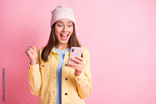 Photo of astonished lady won bet fist up look phone open mouth headwear isolated Canvas Print