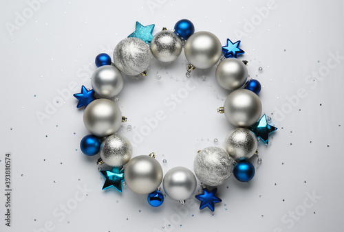 Beautiful festive wreath made of different Christmas balls on white background, top view