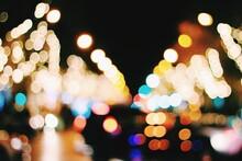 Defocused Image Of Christmas Lights At Night
