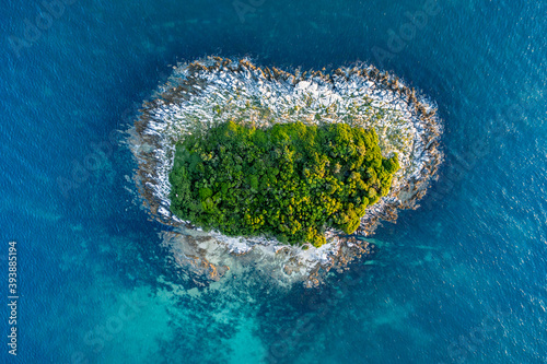 Heart shaped island on the Adriatic sea seen from birds eye perspective Fotobehang