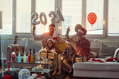 Obraz Happy family enjoying New Year eve together. New Year, holiday, family time together - fototapety do salonu