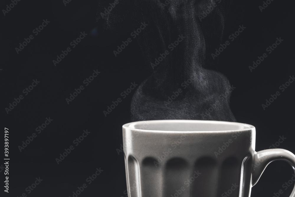 Fototapeta Cup of hot coffee on dark background, closeup