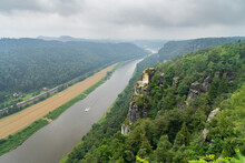 Bastei Is A Sandstone Formation With An Observation Deck In Saxon Switzerland On The Right Bank Of The Elbe River Between The Resort Of Rathen And The City Of Velen