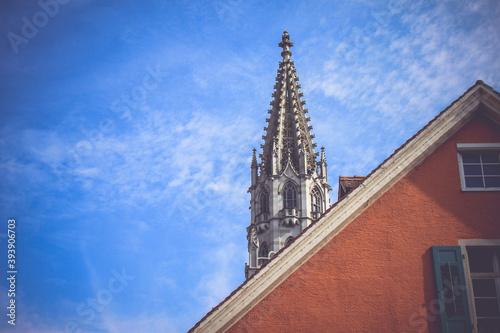 Fotografiet church steeple against blue sky in Konstanz