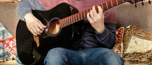 Obraz na plátne Guitar music lessons at home concept