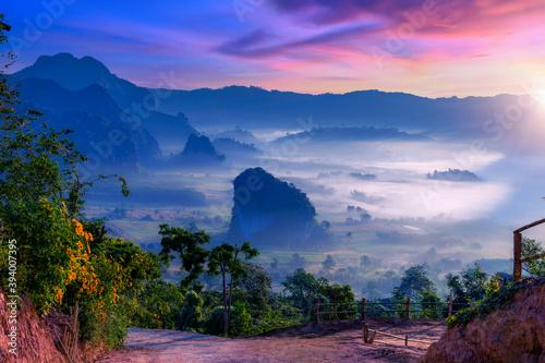 Fotografiet Sunrise and morning mist at Pha Chang Noi Viewpoint, Phu Langka National Park, Phayao Province, Thailand