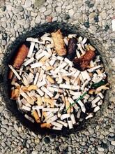 Full Of Cigarettes In Public Ashtray