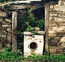 Damaged Washing Machine By Abandoned House