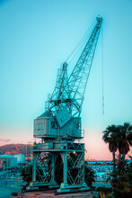 Old Crane In The Port Of Algeciras, (Spain), At Sunset