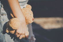 Midsection Of Woman Holding Teddy Bear
