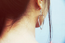 Close-up Of Woman With Heart Shape Earring