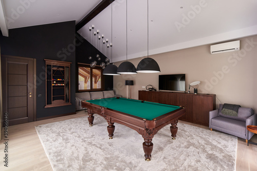 Canvas Print modern billiard room with a beautiful table and large windows