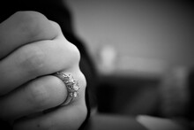 Cropped Hand Of Woman Wearing Diamond Ring