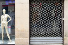 High Street Shop Fashion Clothes Closing Down With Shutters Closed In Concept Decline In Shopping