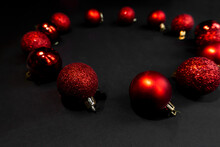 Christmas Round Red Toys On A Black Background