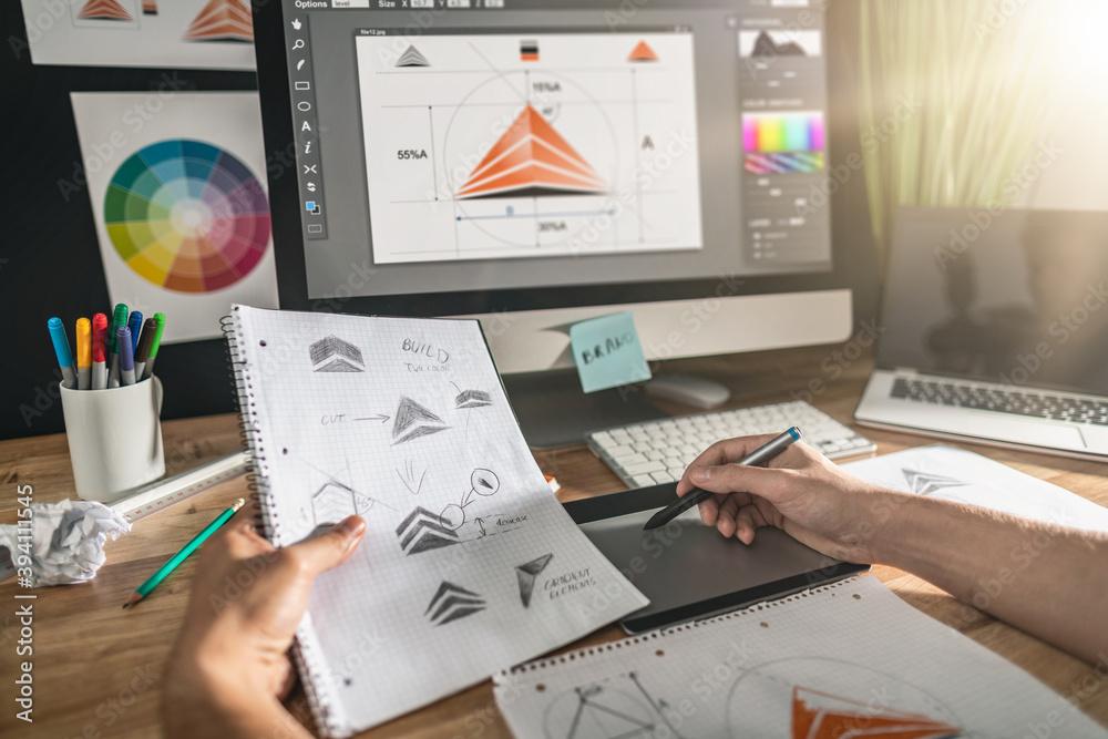 Fototapeta Graphic designer drawing sketches logo design.