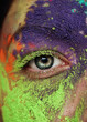 Close-up Portrait Of Woman With Multi Colored Powder Paint