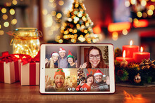 Christmas Video Call With The Family. Concept Of Families In Quarantine During Christmas Because Of The Coronavirus