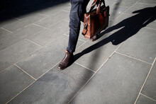 Man Walking To Work Carrying A Briefcase