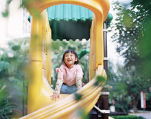 Lovely Asian Children, Playing In Children's Play Area. Shooting By 120 Film