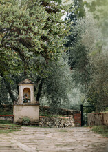 Votive Spot With Holy Mary Image Amongst Olive Trees In Tuscany