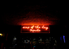 Neon Sign In A Bar.