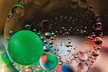 Close-Up, Abstract Of Oil And Water Creating Different Colored Spheres