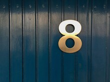 Close-up Of Number 8 On Wooden Door