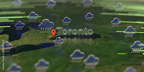 Fototapeta premium Rainy weather icons near Toronto city on the map, weather forecast related 3D rendering