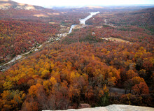 View To Red Colored Trees At Lake Lure And Broad River During Indian Summer From Chimney Rock North Carolina On A Cloudy Autumn Day