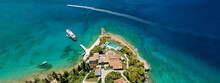 Aerial Drone Ultra Wide Photo Of Chinitsa Bay A Popular Anchorage Crystal Clear Turquoise Sea Bay For Yachts And Sail Boats Next To Porto Heli, Saronic Gulf, Greece