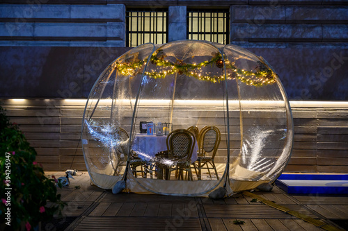 New York, New York, USA - November 20, 2020: An empty outdoor dining bubble or igloo at Bryant Park intended to isolate dining parties during the pandemic.