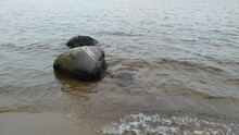 Two Boulder Stones In Lake Lad...