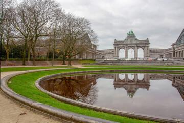 Arc de Triomphe in Sencantener Park in Brusseles and reflection in pond water ( Auti Pavilion - at left corner)