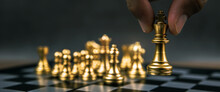 Close Up Hand Choose King Chess From The Golden Team On Chess Board Concepts Of Leadership And Business Strategy And Risk Management.