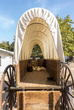 Inside View Of A Covered Wagon With Wood Bed And Canvas Top
