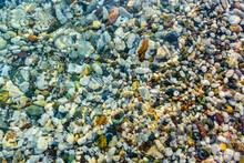 Texture Of Pebbles Under Water...