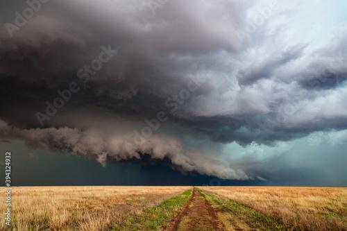 Obraz Storm over a field in Kansas - fototapety do salonu