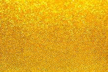 Gold Glitter And Bokeh Background. Abstract Texture Background.