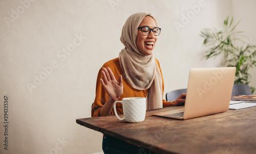 Muslim woman at home having a zoom meeting call Wallpaper Mural