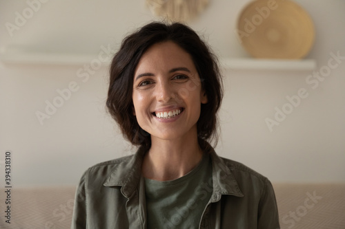 Fototapeta Profile picture of happy millennial caucasian woman posing in own new home apartment. Close up headshot portrait of smiling female renter or tenant satisfied with real estate agency services. obraz