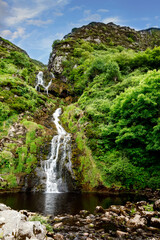 Beautiful water cascade of Powerscourt Waterfall, the highest waterfall in Ireland. Famous tourist atractions in co. Wicklow, Ireland. Near Powerscourt Manor House