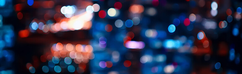 blurred bokeh city background / glare and glowing light in night city, modern beautiful bright background