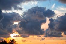 Dark Dense Clouds At Sunset In...