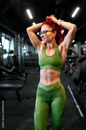 Fototapeta premium Active woman doing workout and legs workout at gym.