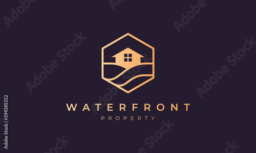 Fotografia hotel logo with a hexagon base shape with ocean wave and window