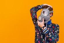 Stylish Strange Woman In Respirator Posing Over Orange Background