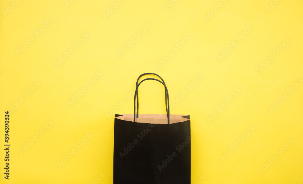 Fototapeta Black friday festival concepts with shopping bag on yellow background
